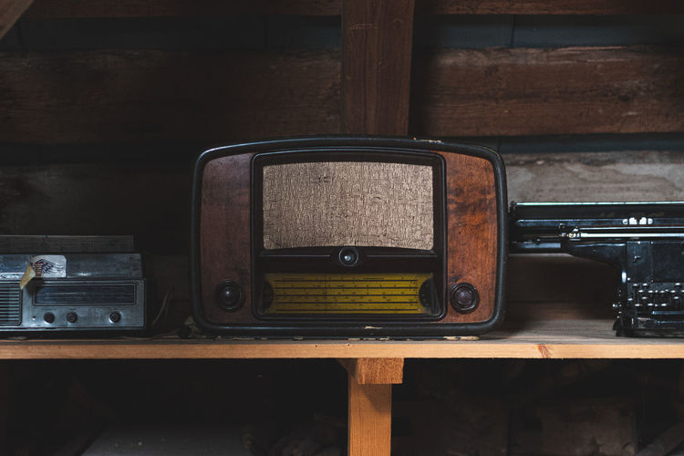 Close-up of old vintage television on table