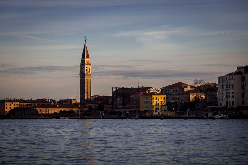 By The Sea Travel Travel Photography Venezia Architecture Building Exterior Built Structure City Cityscape Day Golden Hour Italy No People Outdoors Place Of Worship Religion Sky Spirituality Sunset Travel Destinations Venice Water Waterfront