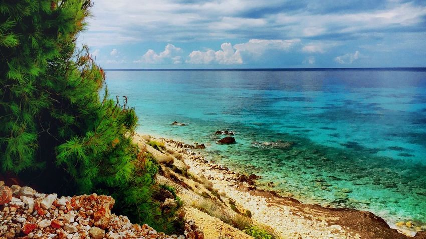 Sea Water Horizon Over Water Tranquil Scene Scenics Tranquility Beach Beauty In Nature Sky Cloud - Sky Non-urban Scene Nature Seascape Shore Tourism Summer Blue Vacations Day Outdoors