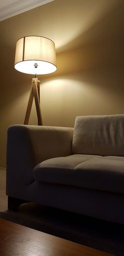 Electric lamp by sofa at home