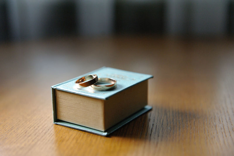 Close-up of wedding rings on box