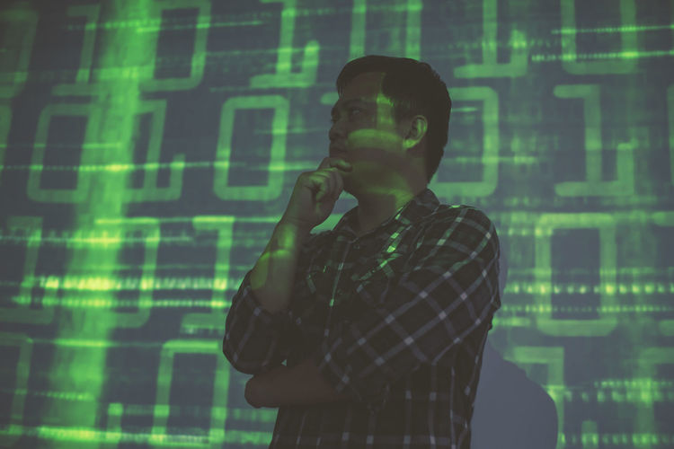 Digital composite image of man using smart phone