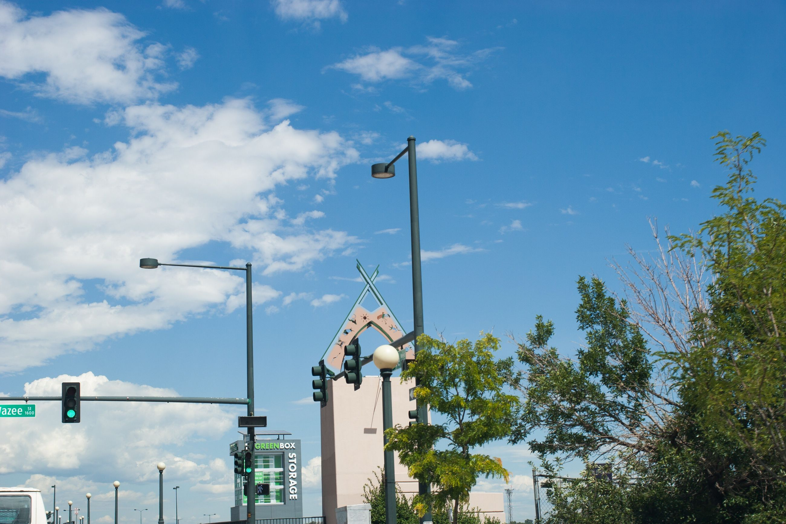 low angle view, sky, street light, cloud - sky, cloud, pole, blue, cloudy, day, outdoors, no people, tall - high, floodlight, high section, nature