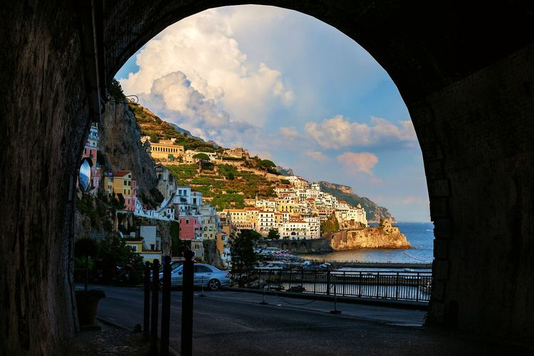 Amalfi Coast Urban Scene Busy Vacation Travel Travel Destinations Famous Places Italian Coast Amalfi  Tunnel EyeEm Selects EyeEm Gallery Holidays Seaside Beach Seascape Bella Italia Italy Water Multi Colored Sea Sky Architecture Built Structure Building Exterior Cloud - Sky Arch