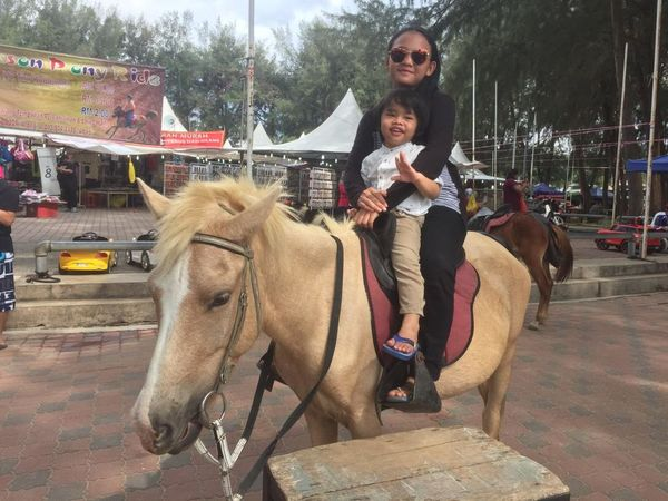 Kashaf and Qilla pony ride Looking At Camera Full Length Front View Riding One Person Lifestyles Portrait Domestic Animals Outdoors