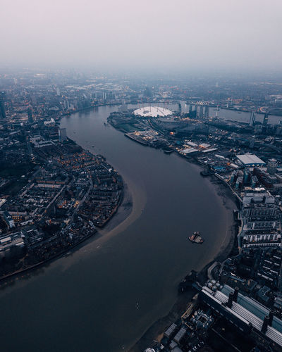 Aerial view of river in city during foggy weather