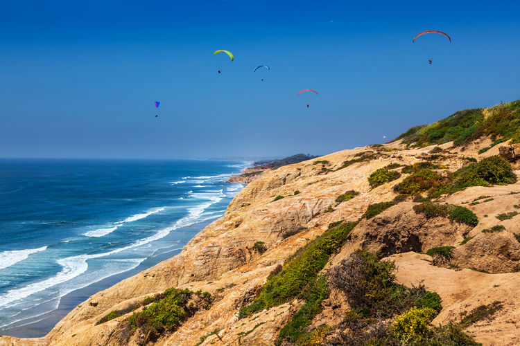 Paragliders from the Torrey Pines gliderport just north of San Diego, California California Cliffs Coastline San Diego Sunny Torrey Pines Beach Blue Sky Day Erosion Flying Landscape Leisure Activity Mid-air Ocean Outdoors Pacific Ocean Parachute Paragliding Sea Soaring Sport Water Wave Windy