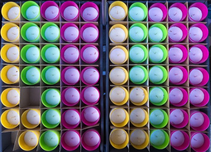 Close-up high angle view of candles in row