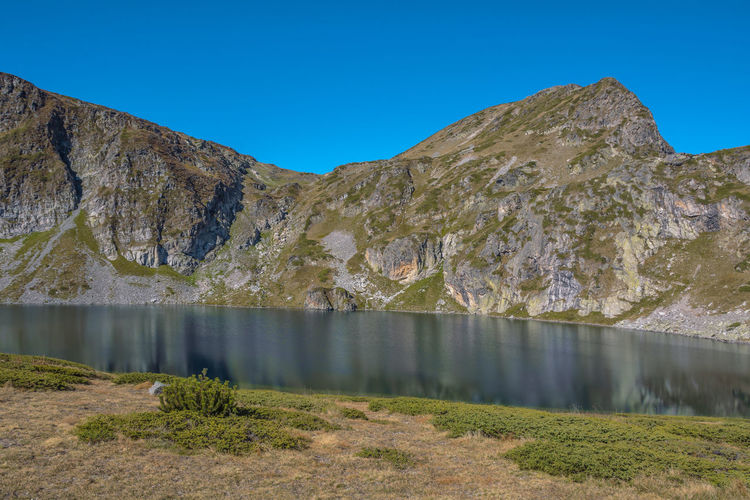 Seven Rila lakes, Bulgaria; The Kidney Бъбрека (Babreka) 2,282 m (7,487 ft) 8.5 ha (21 acres) 28.0 m (91.9 ft) Steepest shores of all Nature Photography Water Mountain Scenics - Nature Lake Sky Tranquil Scene Tranquility Day No People Nature Beauty In Nature Clear Sky Non-urban Scene Mountain Range Blue Idyllic Outdoors Remote Environment Formation Mountain Peak Lake View Lakeside Mountain View Nature Atmospheric Lakeshore Calm Rocky Mountains