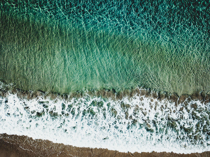 Water Reflections Waterscape Aquatic Sport Beach Beauty In Nature Breaking Clear Water Day Flowing Water High Angle View Land Motion Nature Outdoors Power Power In Nature Scenics - Nature Sea Splashing Sport Surfing Turquoise Colored Water Wave