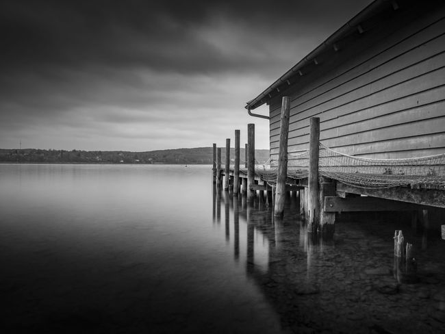 Bootshaus am Starnbergersee Nature Photography Landscape_Collection Blackandwhite Black And White Bnw_collection Bnw #naturelovers Bestoftheday Schwarzweiß EyeEm Best Shots Best EyeEm Shot Hanging Out Bayern Germany Nature_collection EyeEmNewHere Take Photos Safetheplanet Bnwart Water Built Structure Sea Architecture Sky Cloud - Sky Outdoors No People Nature Scenics