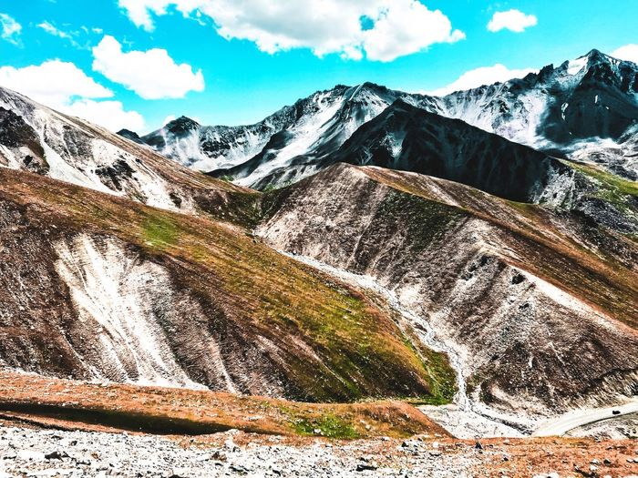Eye exam - where is the car? Traveling Continental Blue Sky Perspective Transportation Road Mountain Range Mountain Valley Sky Mountain Snow Scenics - Nature Day Nature Cloud - Sky Tranquil Scene Tranquility Beauty In Nature Cold Temperature Mountain Range Landscape Snowcapped Mountain Environment Non-urban Scene Land
