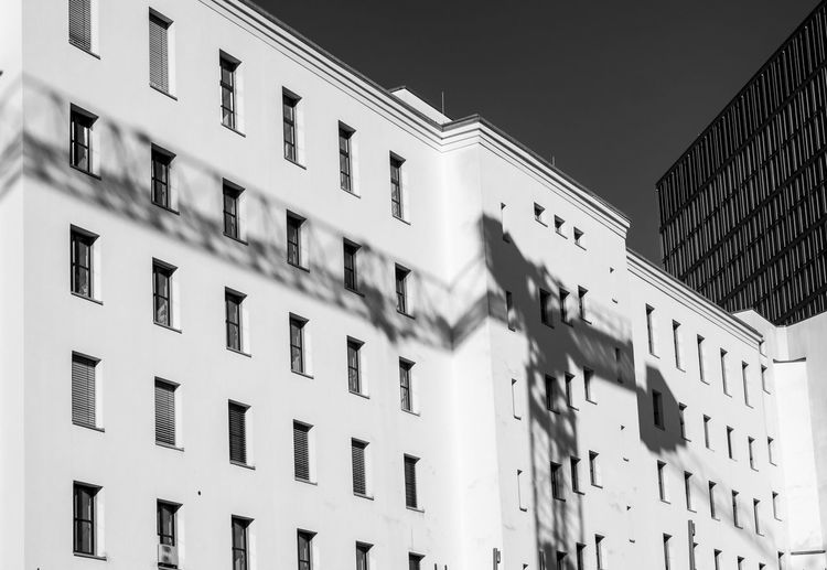 Low Angle View Of Building With Shadow In City