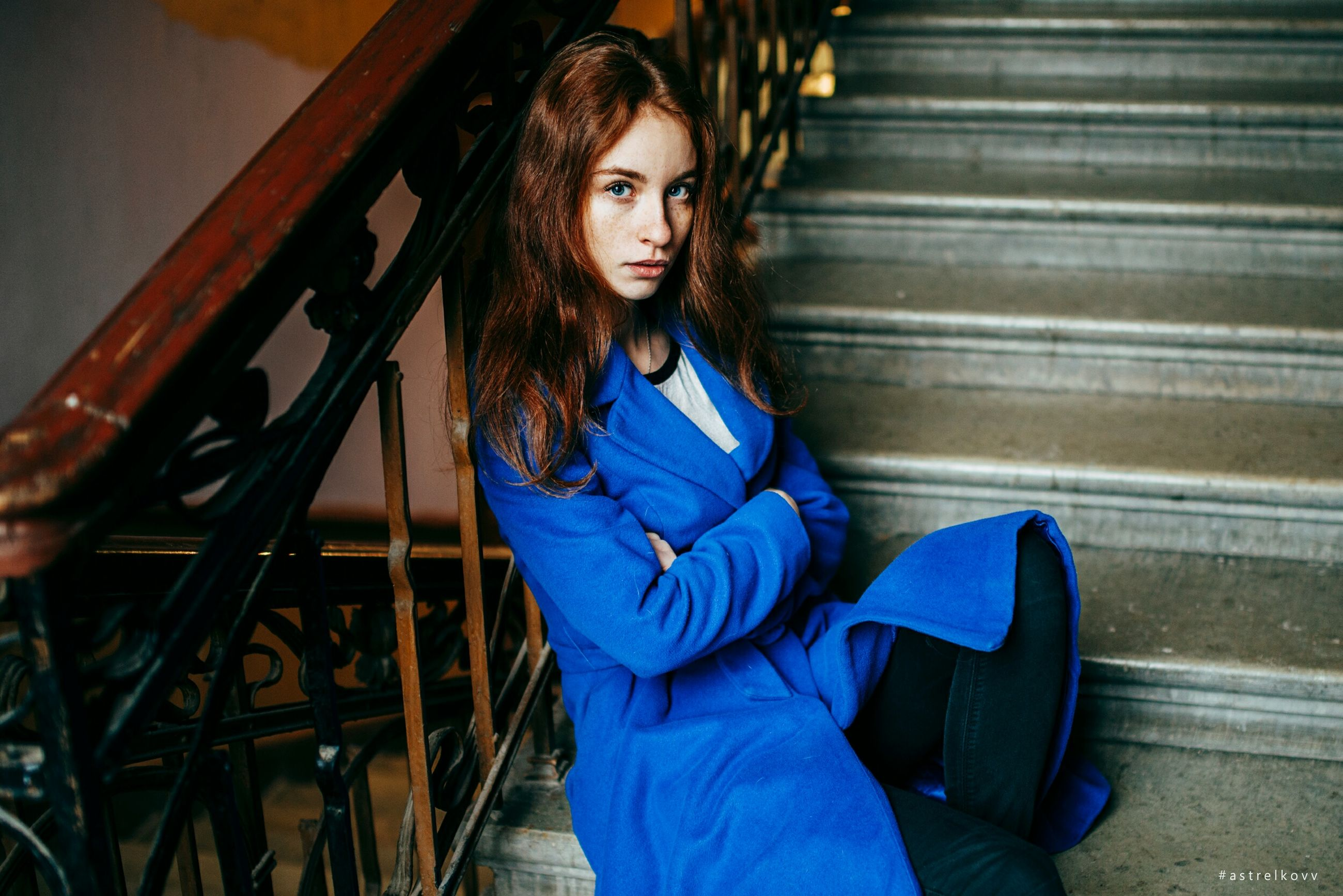 steps, young adult, one person, staircase, beautiful woman, real people, young women, blue, steps and staircases, long hair, front view, sitting, looking at camera, lifestyles, portrait, outdoors, day, people