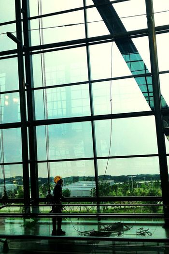 One Person Cleaning Airport Windows Windows Reflection