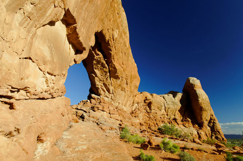 Rock formation against clear blue sky