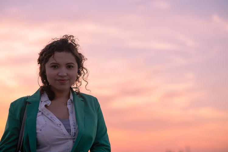 Portrait of woman against orange sky