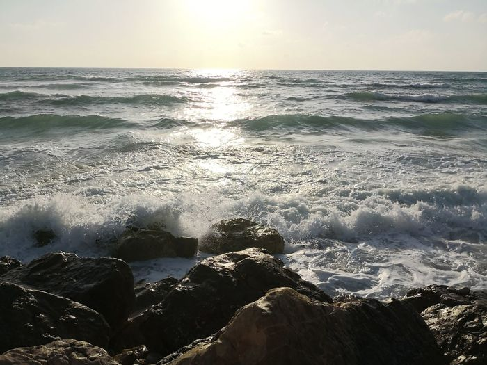 Mediterranean Sea at sunset Mediterranean Coast Israel Tel Aviv Beach Life No People Seascape Water Wave Sea Sunset Beach Backgrounds Sunlight Sun Reflection Blue Atmospheric Mood Coast Rushing Dramatic Sky Low Tide Rocky Coastline Sky Only Seascape Coastal Feature Romantic Sky Tide Moody Sky Surf