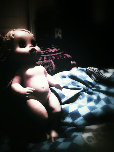 Doll Creepy Creepy Doll Darkness And Light Darkness Dark In The Dark Spotlight Girl Stuff Girl Toy Toy Kids Stuff Kids Things No Clothes  Naked Doll Baby Doll Childs Playthings Childs Room Plastic Doll Nude Doll Mood Girl Things Eerie Glow Play Things
