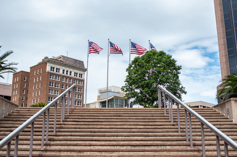 Architecture Built Structure Staircase Building Exterior Sky Cloud - Sky Low Angle View Flag Railing No People Steps And Staircases Day Nature Patriotism Tree Plant City Building Outdoors National Icon USA Destination Travel Destinations Us Trip