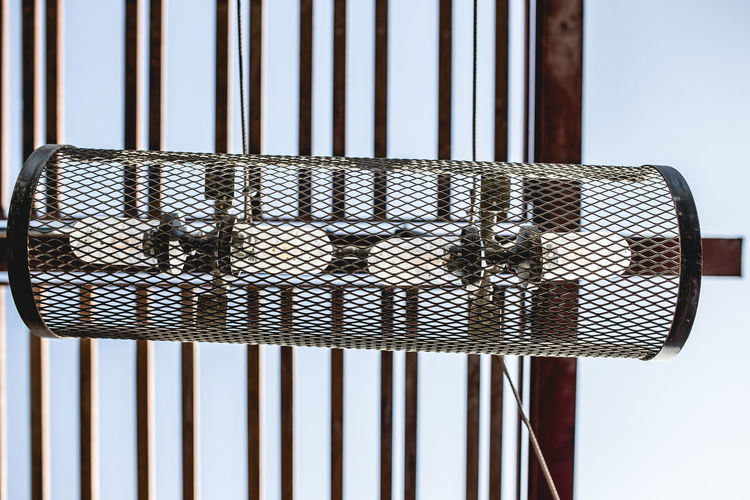 H Chair Close-up Day Indoors  No People Sky Prison Cell Hooded Beach Chair Prison Bars Prisoner Confined Space Crisscross Punishment Police Station Justice - Concept White Collar Crime Criminal Handcuffs  Trapped Security Bar Metal Grate Arrest Whicker Cage Prison Grate Birdcage