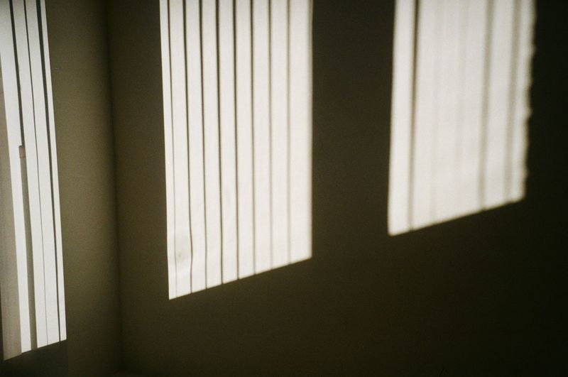 Window Indoors  Curtain No People Home Interior Shadow Sunlight White Color Domestic Room Day Close-up Pattern Textile Blinds Wall Nature Wall - Building Feature Dark House Focus On Shadow