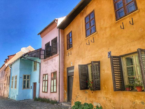 Medieval towns Sighisoara-Romania EyeEm Best Shots EyeEm Gallery Facades Colorful Houses Eye Em Around The World Quaint Places Historical Building Medieval Town Eastern Europe Street Photography Architecture Building Exterior Built Structure Building Window Sky Residential District Day No People Outdoors Sunlight House Clear Sky Wall - Building Feature Street