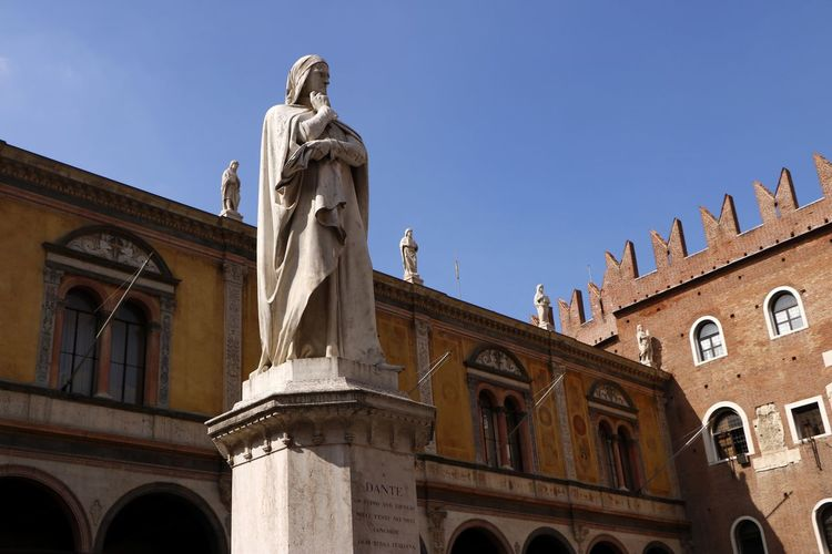 A statue to Dante in Piazza dei Signori, Verona, Italy, erected in 1865 Sculpture Human Representation Statue Architecture Art And Craft Representation Low Angle View Building Exterior Built Structure Male Likeness No People Clear Sky Arch Building Travel Destinations The Past History Architectural Column Dante Piazza Dei Signori Travel Travel Photography Tourist Destination Historical Monuments Monument