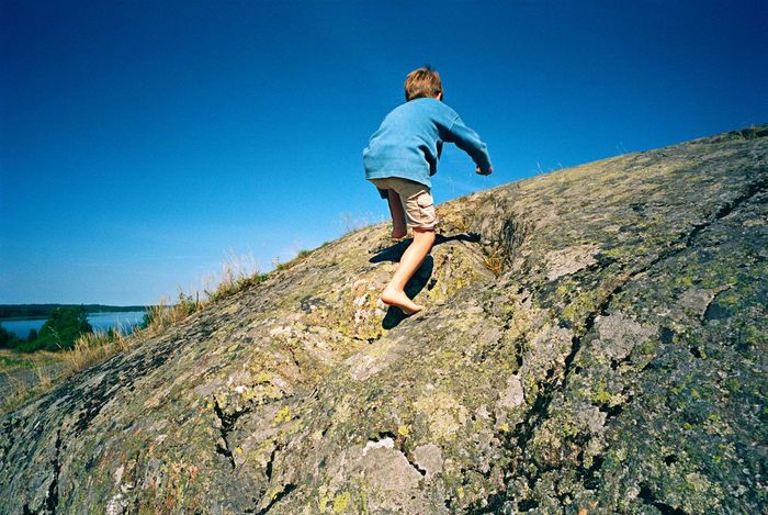 The Only Way Is Up EyeEm Selects Rock Skerry Landscape Self Control Trust Self Assurance The Way Forward Climbing Child Boy Full Length Real People Leisure Activity Lifestyles One Person Sky Nature Clear Sky Sunlight Low Angle View
