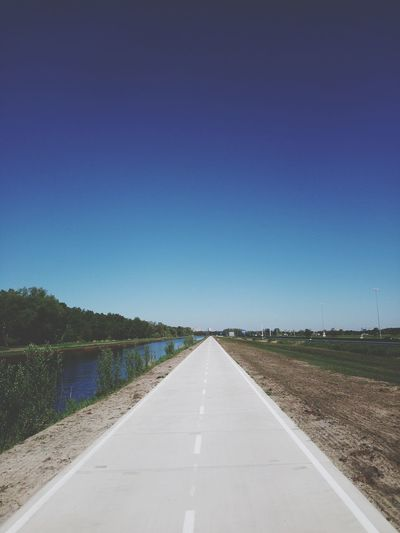 A perfect day for cycling Clear Sky Road Blue Straight Astronomy Diminishing Perspective Sky Landscape Empty Road vanishing point The Way Forward