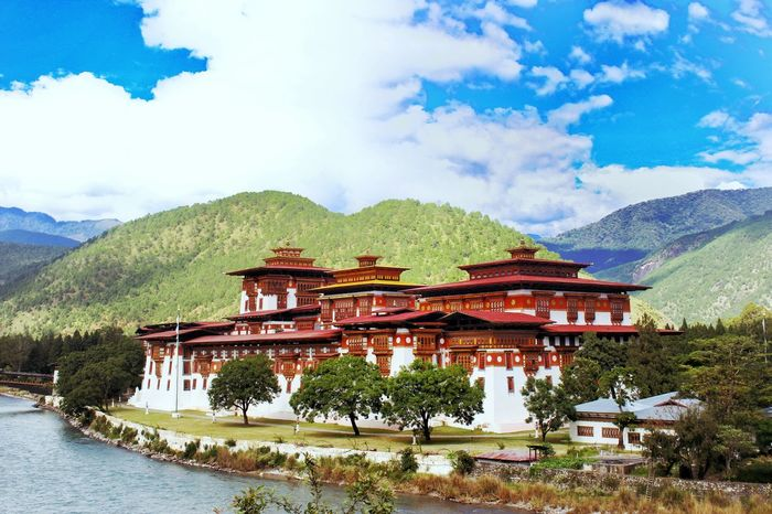 Punakha Dzong Monastery Monastery Of Stone Architecture Travel Destinations Cloud - Sky Travel Scenics Riverside Riverbank