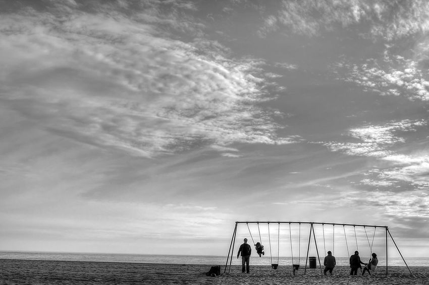 Sway to the waves Santa Monica Beachphotography Pacific Coast Supernormal Minimalism Swing Beachphotography Photography In Motion Blackandwhite Streetphotography Lost In The Landscape California Dreamin Beach Volleyball Dramatic Sky