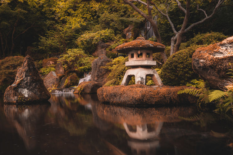 Inside the Japanese Garden of Portland, Oregon Japanese Garden Oregon Portland Architecture Beauty In Nature Built Structure Day Formal Garden Lake Nature No People Outdoors Plant Reflection Rock Rock - Object Solid Tranquility Tree Water Waterfront