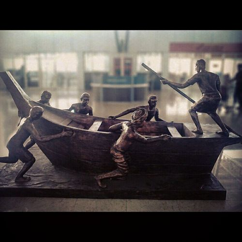 A sculpture at the Chennai International Airport. Boat Rowing Boatmen Sculpture art