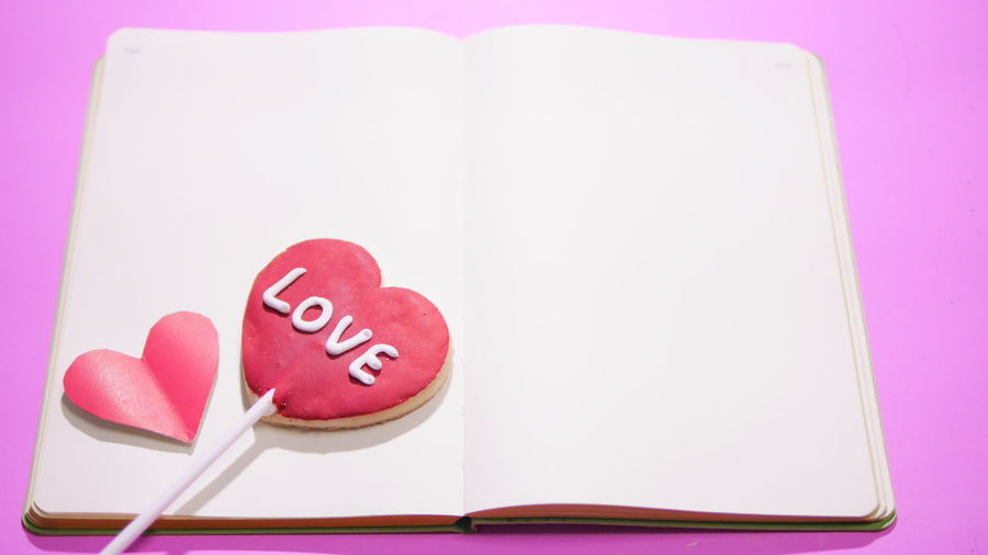 Close-up of heart shape on pink table