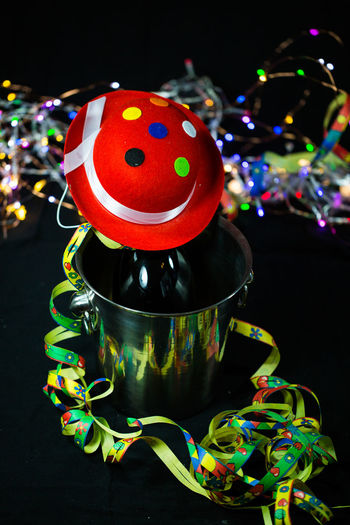 Black Background Celebration Champagne Bucket, Champagne Bucket, Lift With Champagne Bucket Christmas Decoration Close-up Clown Freshness Indoors  Multi Colored Night No People