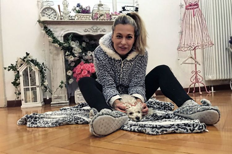 Confidence  Loyalty Bonding Friendship Poodletoy Poodle Dog Indoors  Home Interior One Person Sitting Looking At Camera Real People Smiling Front View Full Length Hardwood Floor Happiness Lifestyles Blond Hair People Mammal Portrait Childhood