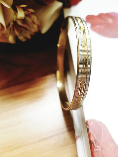 Close-up of engagement ring by book on table