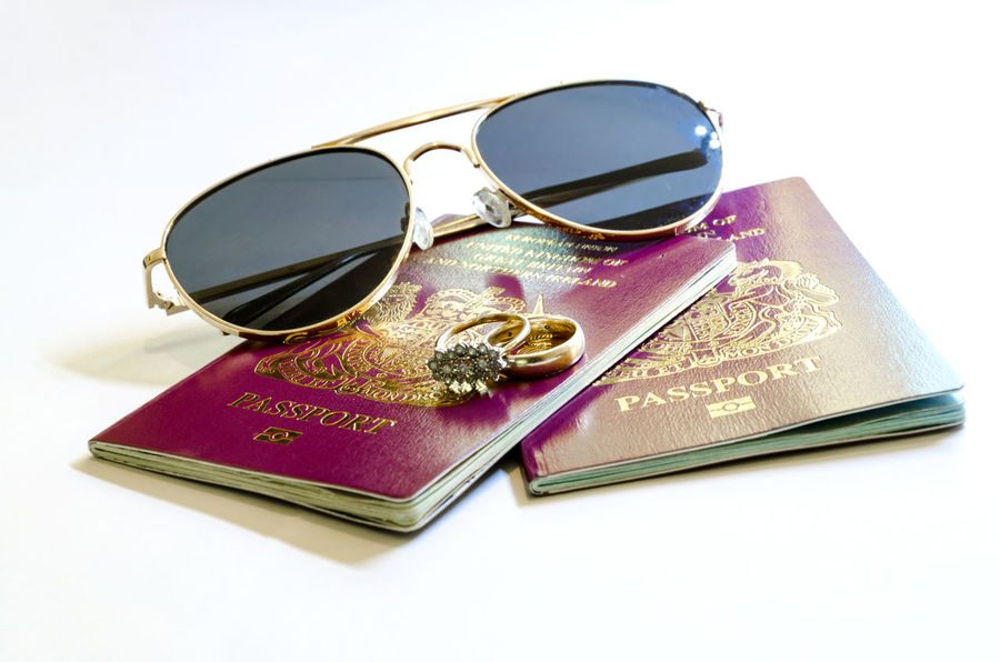 Travel Concept - Passport and Sunglasses British European  Holiday Immigration Official Passport Passports Travel United Kingdom Vacations Burgundy Citizenship Close-up Concept Document Glasses Honeymoon Identification Idyllic Legal Still Life Studio Shot Sunglasses Tourism White Background
