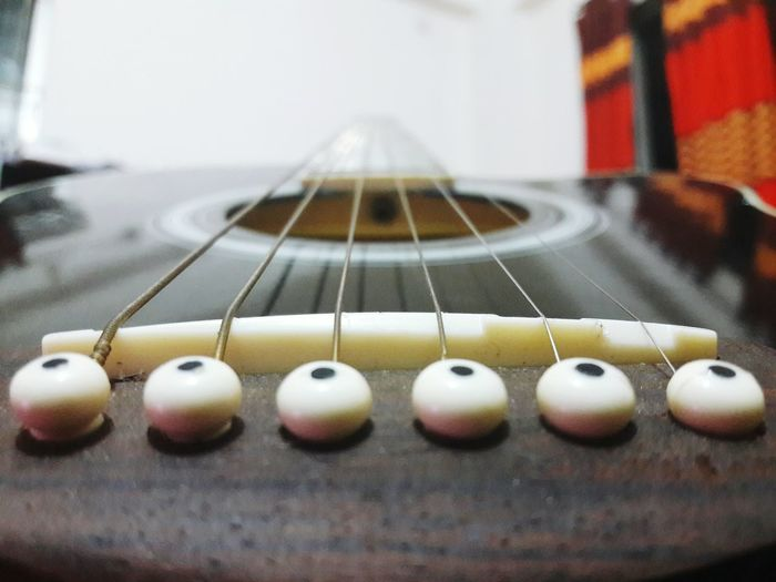Hobbies Musical Instrument Single Object Close-up Music Arts Culture And Entertainment Indoors  Selective Focus Still Life Guitar Focus On Foreground String Extreme Close-up String Instrument Diminishing Perspective In A Row Surface Level Extreme Close Up Beige