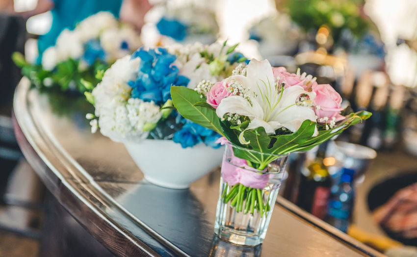 Close-Up Of Posies Arranged On Table