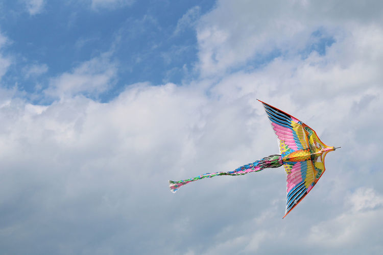 Low angle view of kite flying in the sky