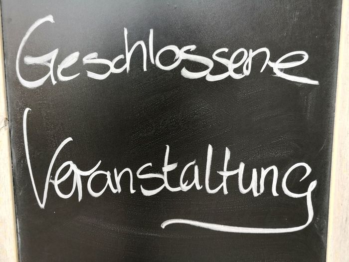 Sign saying Geschlossene Gesellschaft, coterie or private function Private Function Geschlossene Gesellschaft Coterie Blackboard  Text Handwriting  Close-up Short Phrase Thank You Sayings Information Information Sign Western Script Capital Letter Admiration Announcement Message Signboard Board Directional Sign Written Message Menu Single Word Commercial Sign Exclamation Point Sign