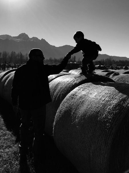 Monochrome Photography Textures Of Life Men Mountain Clear Sky Rear View Lifestyles Extreme Sports Rural Scene Outdoors Person Textured  Getty Images Photooftheday EyeEm Gallery Fresh On Eyeem  Fathers And Sons Family Time Learning To Trust Life In Motion Black And White Friday