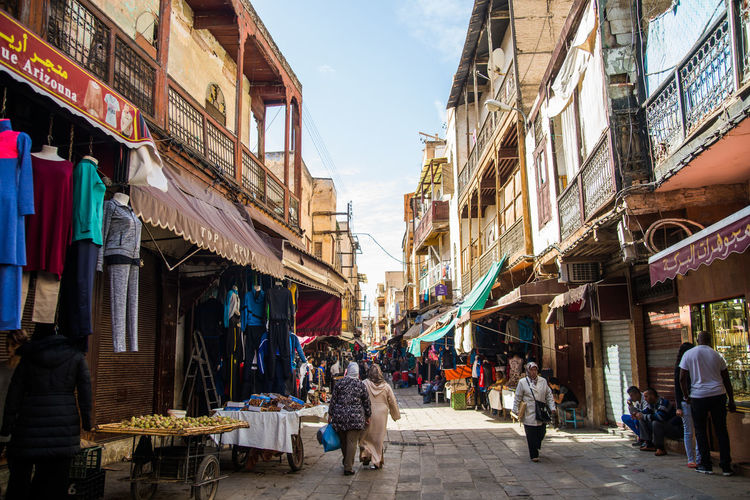 Adult Adults Only Architecture Building Exterior Built Structure City City Street Day Market Men Morocco Outdoors People Retail  Sky Store Street Travel Destinations Women