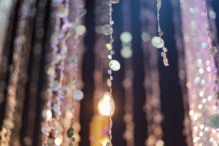 Hanging No People Illuminated Close-up Selective Focus Decoration Focus On Foreground Nature Jewelry Outdoors Full Frame Multi Colored Pattern Bead Lighting Equipment Curtain Glowing Celebration Necklace Day