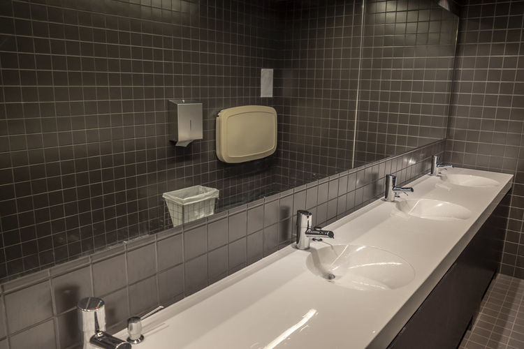 Modern Bathroom. Architecture Creativity In A Row Mirror Modern Sink Tilt Automatic Bathroom Bathroom Sink Brown Color Built Structure Clean Color Design Indoors  No People Public Restroom Side By Side Tap White