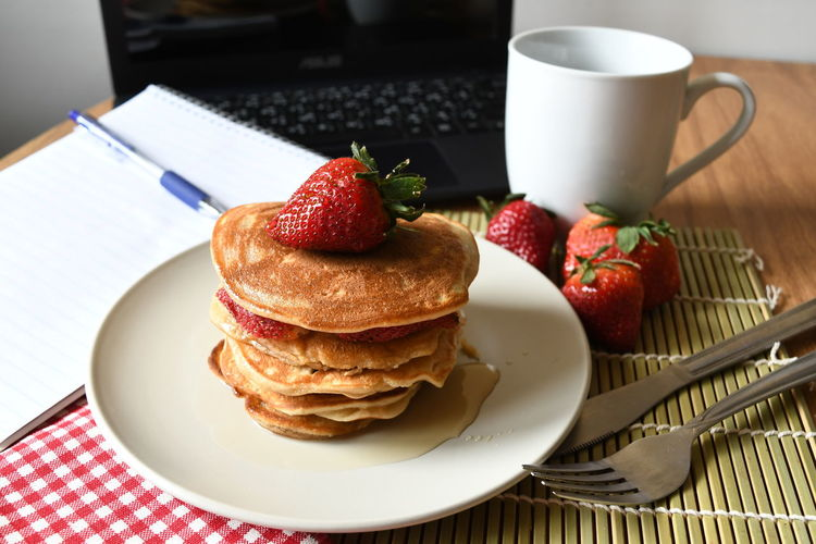 pancake for breakfast Breakfast Meal Morning Close-up Coffee Cup Day Food Food And Drink Fork Freshness Fruit Fruits Healthy Eating Indoors  Indulgence No People Pancake Pancake In Syrup Plate Ready-to-eat Red Strawberry Sweet Food Table Working At Home