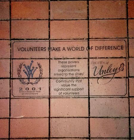 Sidewalk Discoveries Paving Blocks Volunteers Volunteers Make A World Of Difference Paving Bricks Volunteer Work Volunteer Pavers Paving 2001 International Year Of Volunteers Taking Pictures Taking Photos Sign Sidewalks Sidewalk Photography Pedestrian Path Pavementporn Pavements Pavement Signs Red Brick Path Pavementblocks Red Pavers Bricks Red Bricks