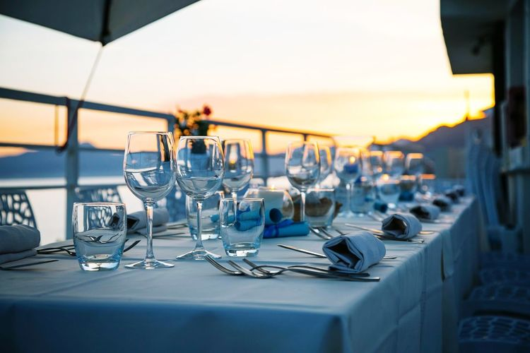 Chairs and tables in restaurant at sunset